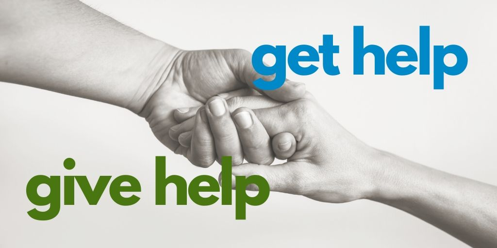 give help, get help - hands reaching out to each other