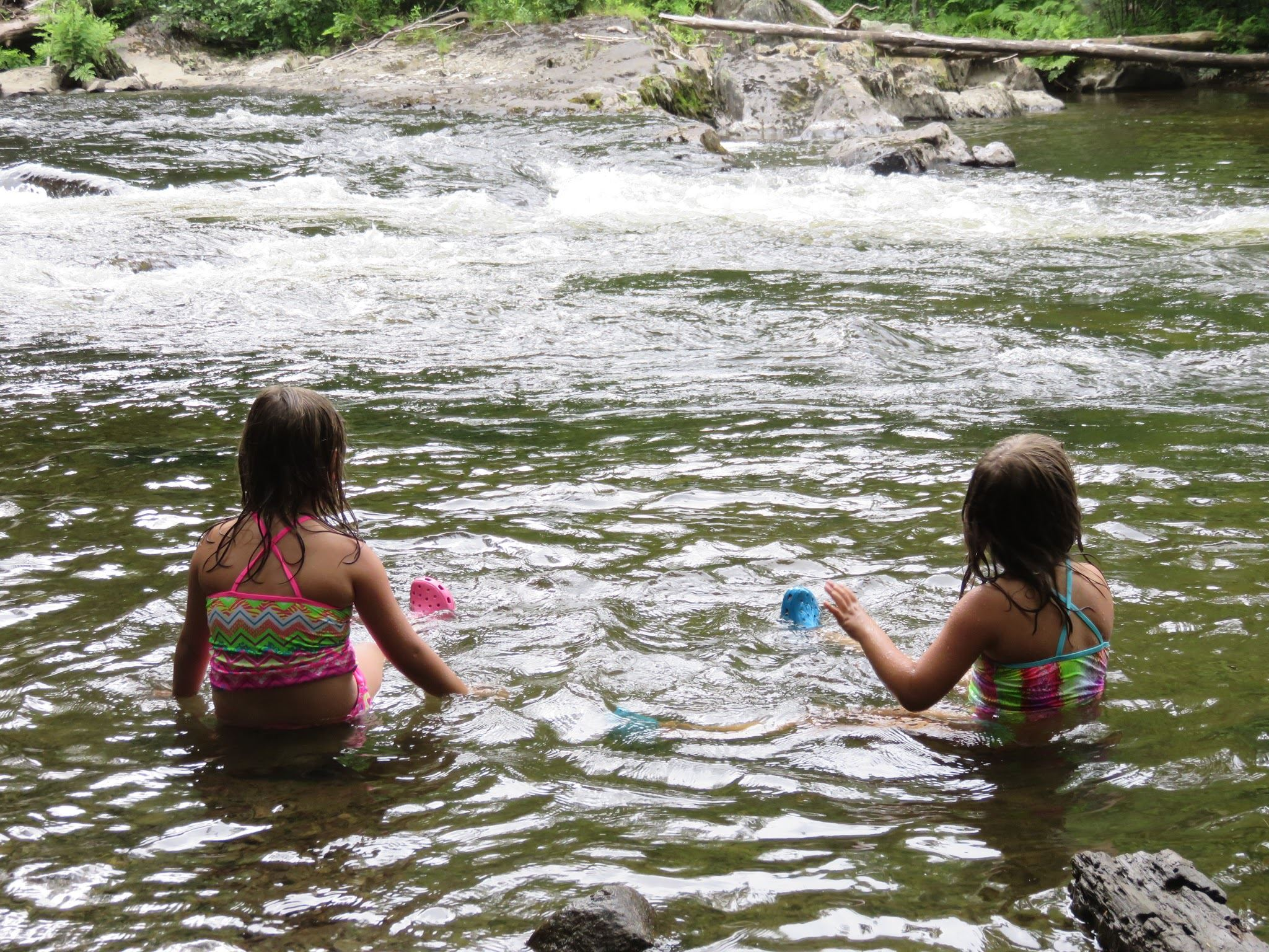 Two girls playing in river