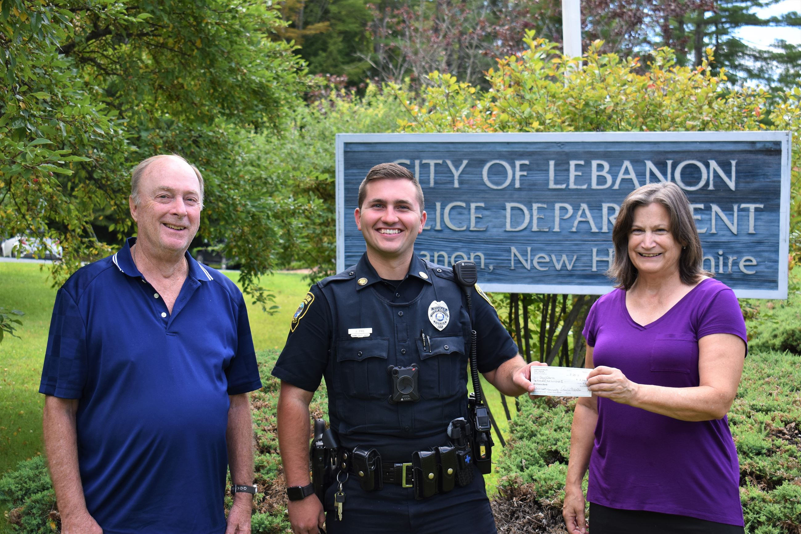 Officer Pike Accepting Thor's Stone Fundraiser Donation