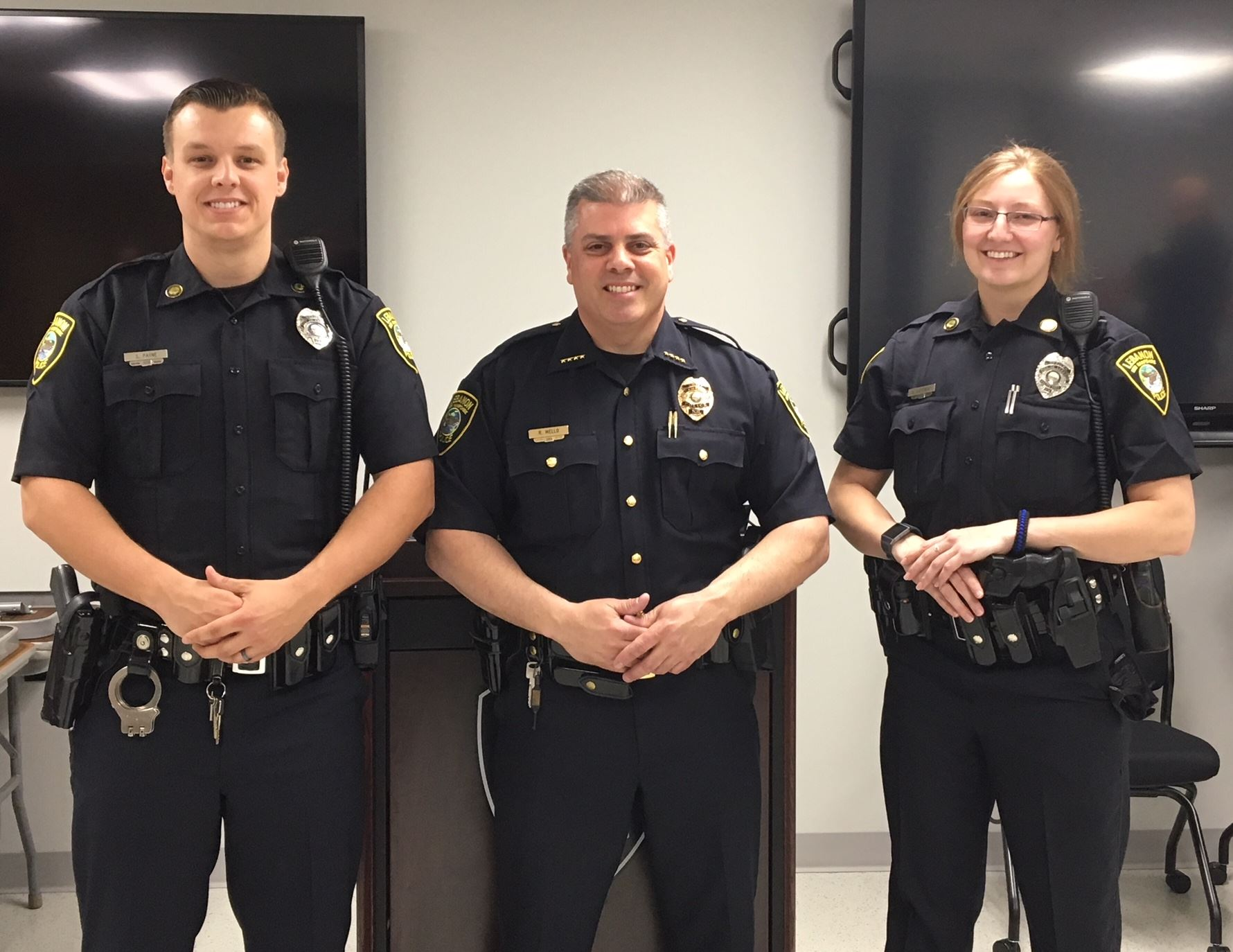 Officer Payne, Chief Mello, Officer Corcoran standing together