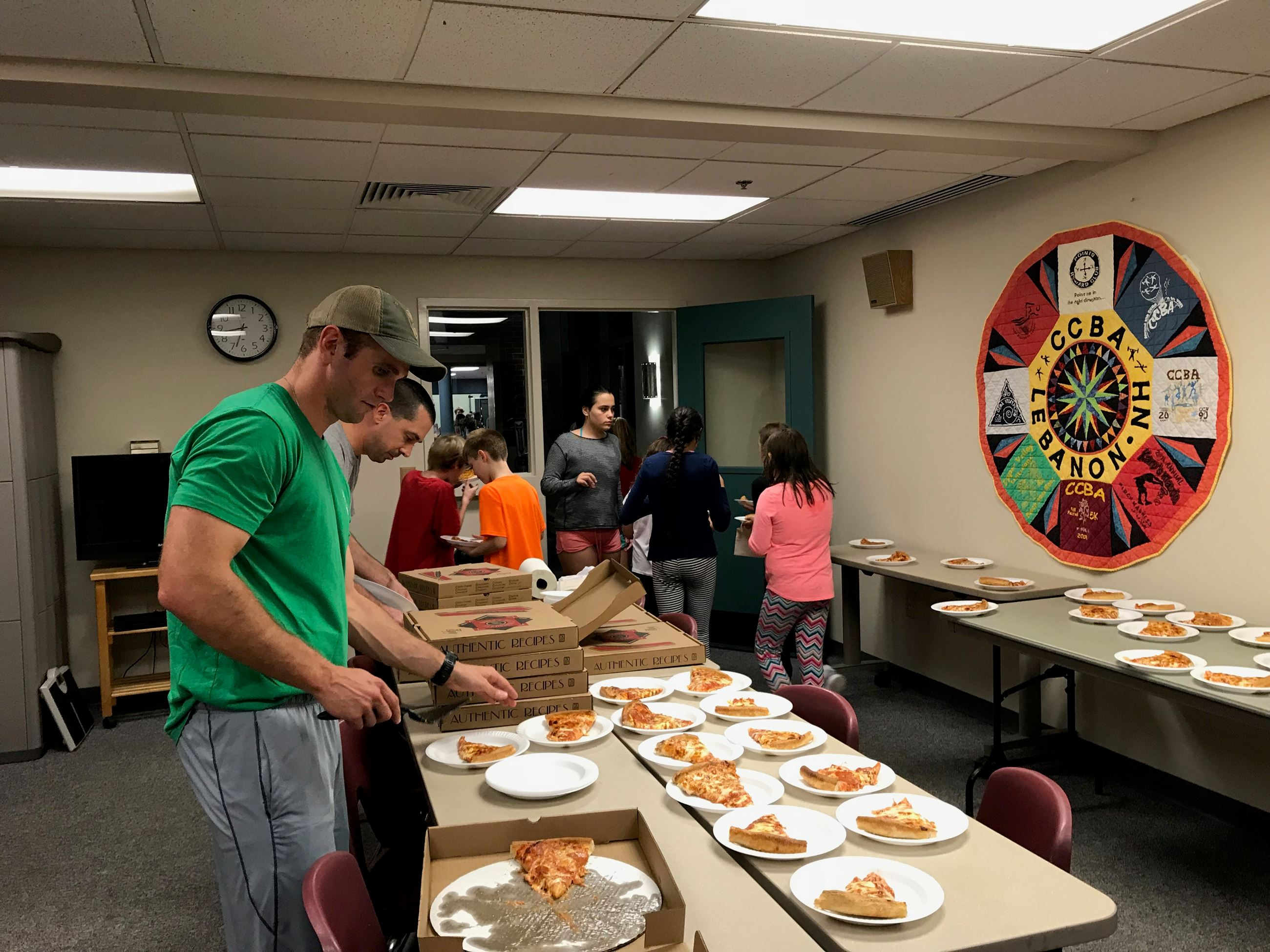 Corporal Hubert and Sergeant Norris serving pizza at Lock-In