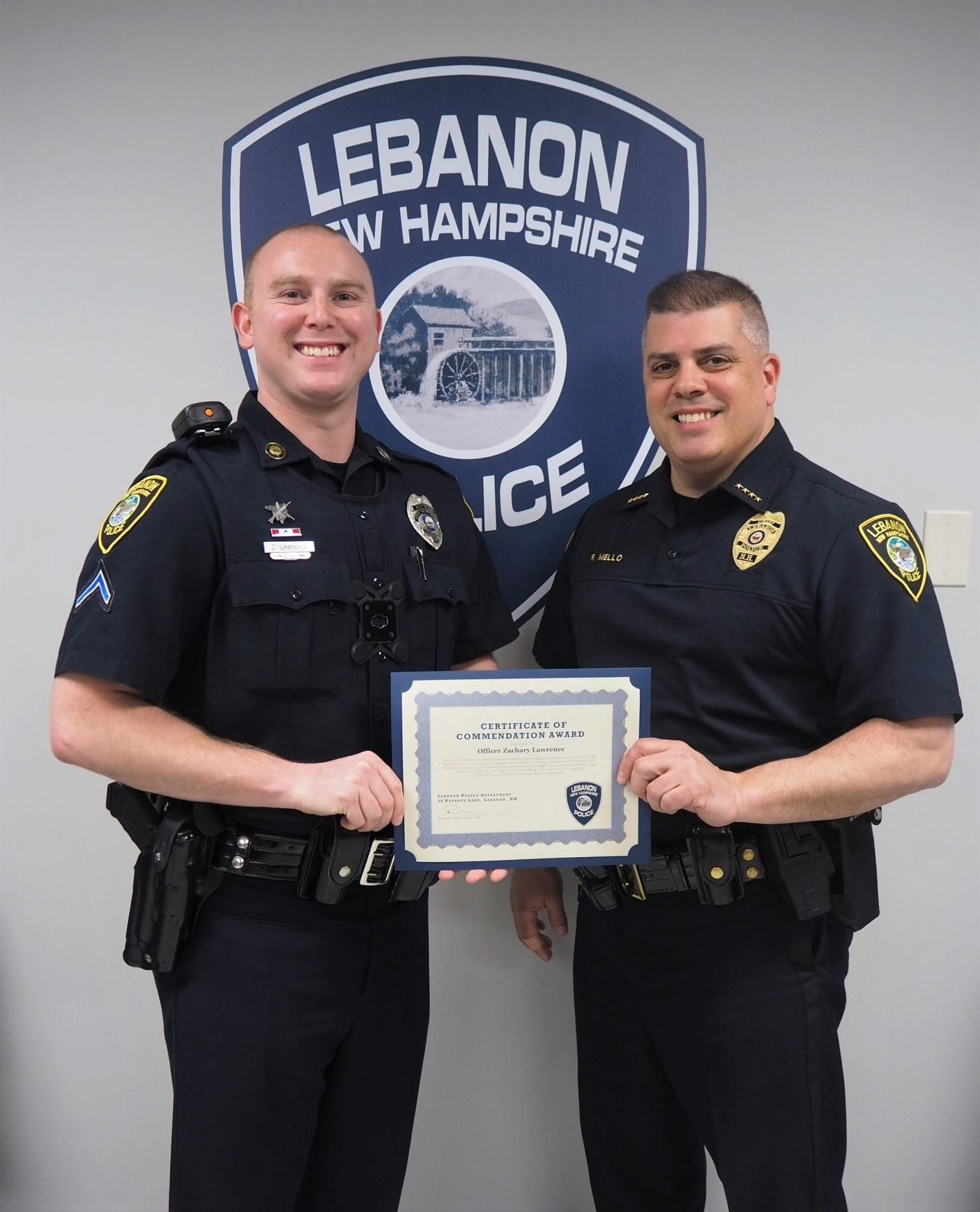 Photo of Officer Lawrence and Chief Mello
